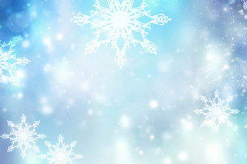 Blue blurred winter snowflakes background,christmas backdrop.