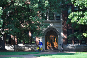 A student rides his bike past Garland Hall at Vanderbilt University in Nashville