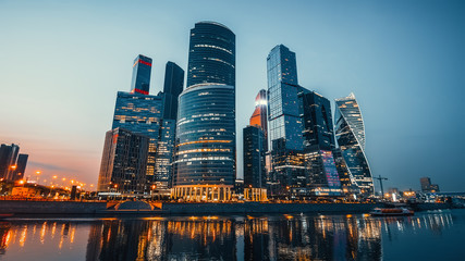 Panoramic view of Moscow city and Moskva River after sunset. New modern futuristic skyscrapers of Moscow-City - International Business Center Wall mural