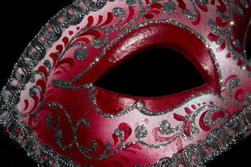 Venetian Masquerade Red and Silver Ball Mask on Black Background
