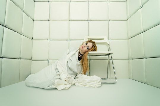 girl in a straitjacket
