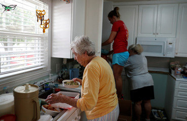 Virginia Gantt (C) organizes the removal of her kitchen items with the help of her family before flood waters arrive in the aftermath of Hurricane Florence now downgraded to a tropical depression in Conway