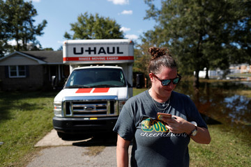 Home owner Candace Johnson stands outside her home before evacuating from coming flood waters in the aftermath of Hurricane Florence now downgraded to a tropical depression in Conway