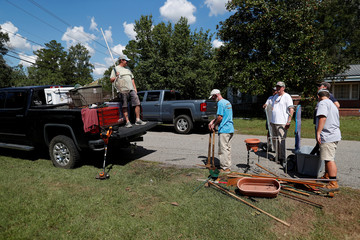 Neighbors help Bob and Virginia Gantt remove the contents of their home before flood waters arrive in the aftermath of Hurricane Florence now downgraded to a tropical depression in Conway