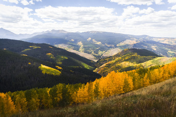Landscape view of the Rocky Mountains during autmn as the leaves change colors.