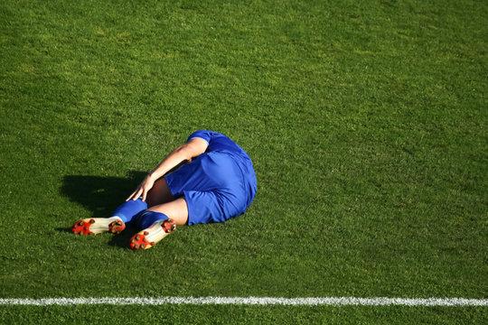Injured football player