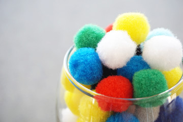 Pom poms in glass. Funny and vivid background concept