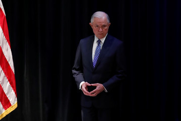 United States Attorney General Jeff Sessions acknowledges applause in Waukegan
