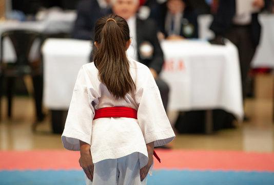 girl karatek preparing to make kata at the championship