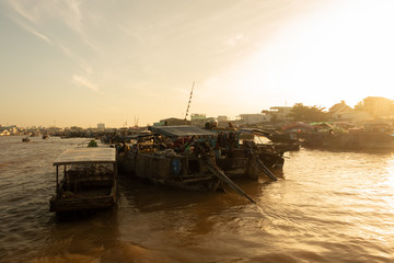 Tourists, people buy and sell food, vegetable, fruits on vessel, boat, ship in Cai Rang floating market, Mekong River. Royalty stock image of traffic on the floating market or river market in Vienam
