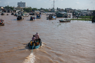 Traffic and transport on floating market by vessel, boat, ship in Cai Rang floating market at Mekong River. Royalty free stock image of the floating market or river market in Can Tho, Vietnam