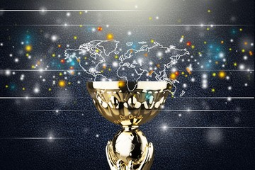 Golden trophy cup on light background