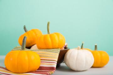 Mini pumpkins on green