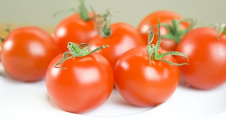 Wall Mural - Tomato on a white plate
