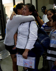 OFW weeps before leaving to work in Riyadh at Ninoy Aquino International Airport in Pasay