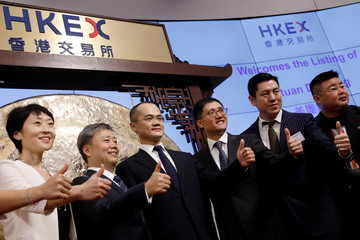 Meituan Dianping's Wang Xing attends the debut of the company at the Hong Kong Exchanges in Hong Kong