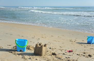 Children's sand buckets at the beach