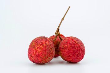 Three lychee fruit on white background