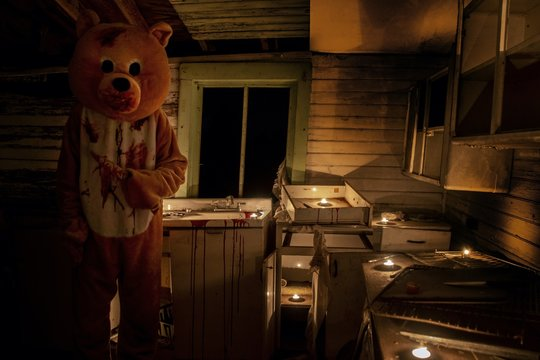 An Evil Bear in his lair on Halloween Night with the Blood of his Victims