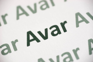 word Avar language printed on paper macro