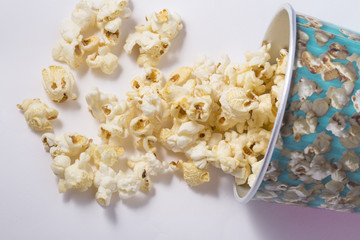 Popcorn in cardboard box isolated on white background