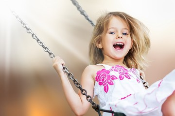 Little child blond girl having fun on