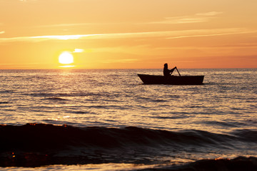 Sunset at the sea and boat