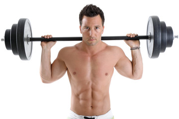 Bodybuilder exercising with barbell in front of white background