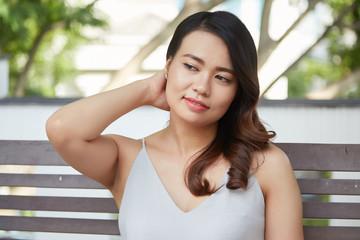 Portrait of beautiful young Asian woman touching her hair
