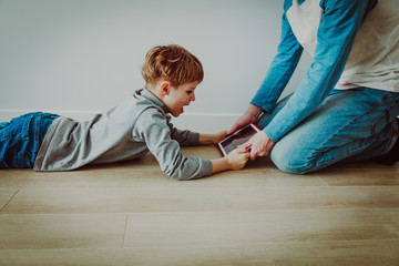 computer addiction- father taking touch pad from angry child