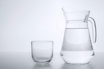 Glass transparent jar filled with clean water. Empty glass.