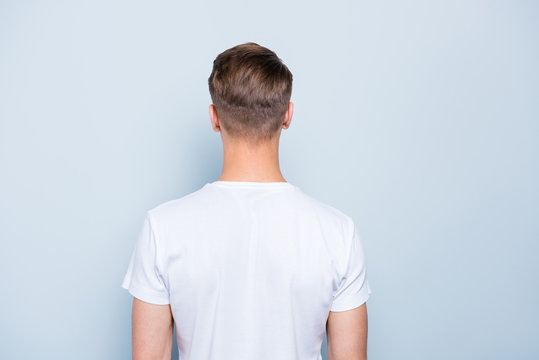 Back rear view photo of confident, attractive, nice-looking man