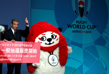 Hiroshi Tachi, actor and Rugby World Cup 2019 PR Captain, poses next to G, an official mascot for the 2019 Rugby World Cup in Japan, during a kick-off event to mark one year to go to the Rugby World Cup 2019, in Tokyo