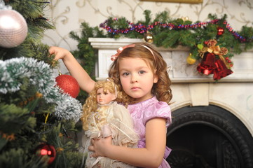 Child decorate on Christmas tree. Old photo