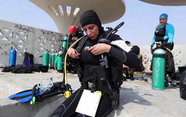 Saudi female divemaster wears her diving equipment at Half Moon Beach open-water dive site in Dhahran
