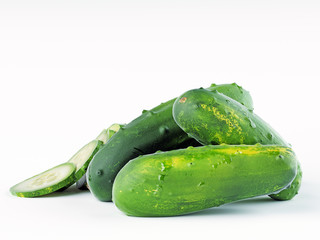 Green fresh cucumbers on a white background.