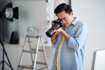 Prefessional Asian photographer busy with work in studio