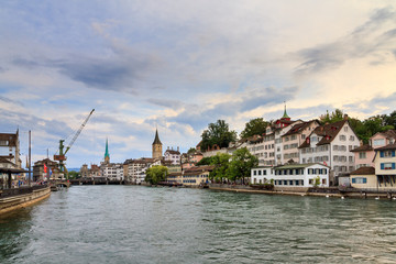 Beautiful summer cityscape of the city Zurich, Switzerland, with the big crane at the river Limmat in the afternoon