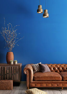 Simple urban style interior with brown sofa and blue wal.