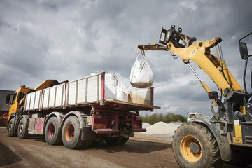 Wall Mural - Excavator moving sand in a gravel pit