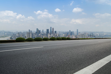 Road pavement and Chongqing urban architecture skyline