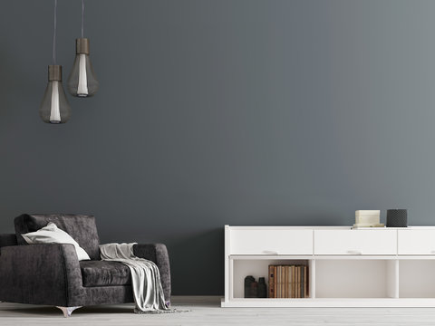 Contemporary black interior with a chest of drawers and a chair in a modern style.