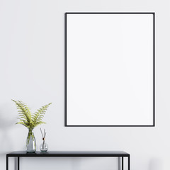 Mockup poster above the table with a plant in a glass vase.