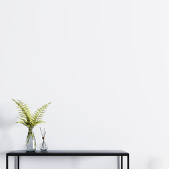 Empty wall for mockup poster with table and plant in a glass vase.