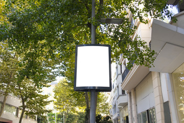 Mock up. Advertising template on the pole in street Fotomurales