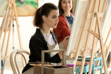 Female student during classes in school of painters