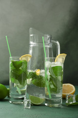 Composition with fresh mojito on green table