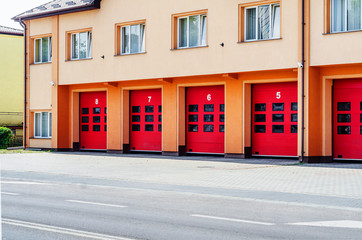 Fire station building, red gate for fire trucks