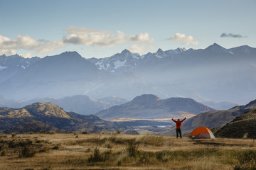 hiker at Chacabuco Valley with a view over the Jeinimeni Mountain peaks, Parque Patagonia, AysŽn Region, Chile.