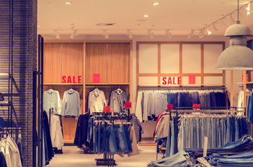 Clothing store, the word sale on the shelf of the store